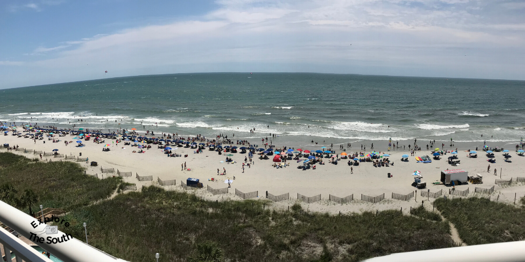 A panoramic view of the ocean from a balcony
